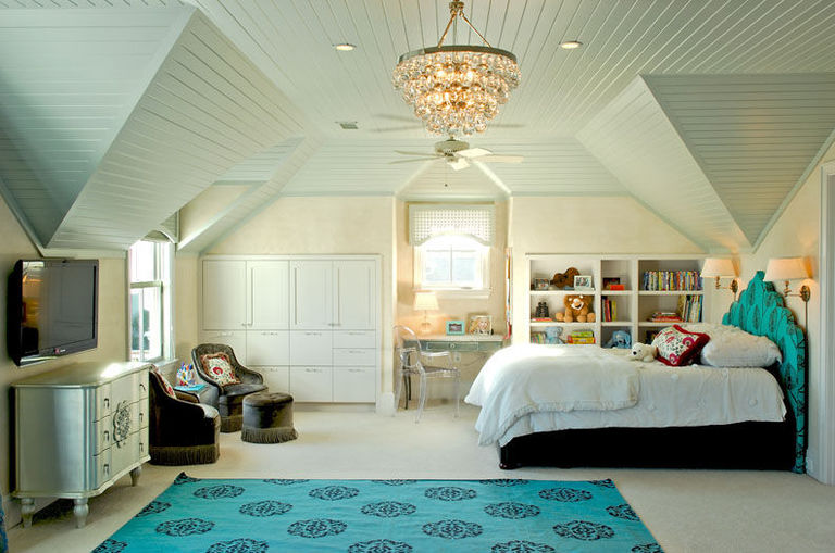 Blue and white girl's bedroom with white vaulted ceiling
