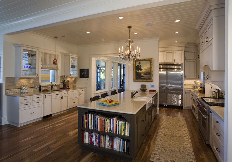 Expansive kitchen with fun details such as kitchen island built-in book shelves