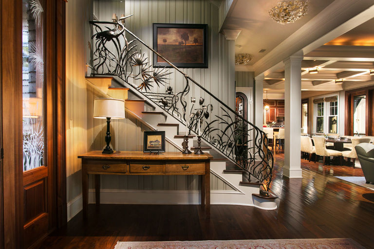 Foyer with heron sculptural iron stair railing