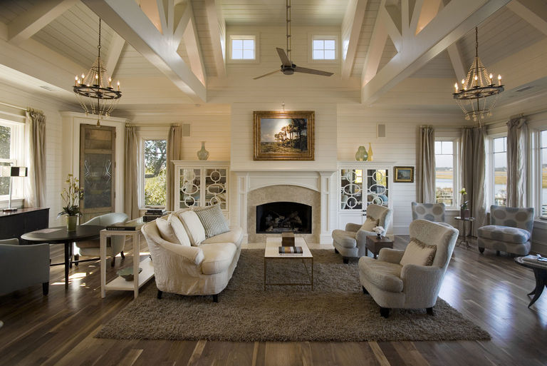 High vaulted ceilings in this neutral palette living room