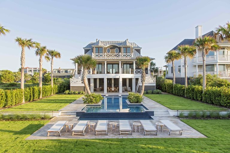 Isle of Palms home with curved palm trees, Palm tree lined, herlong architects, charleston architecture, coastal architecture, coastal architects