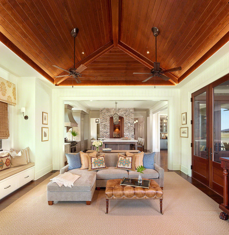 Living room with vaulted ceiling and marsh views