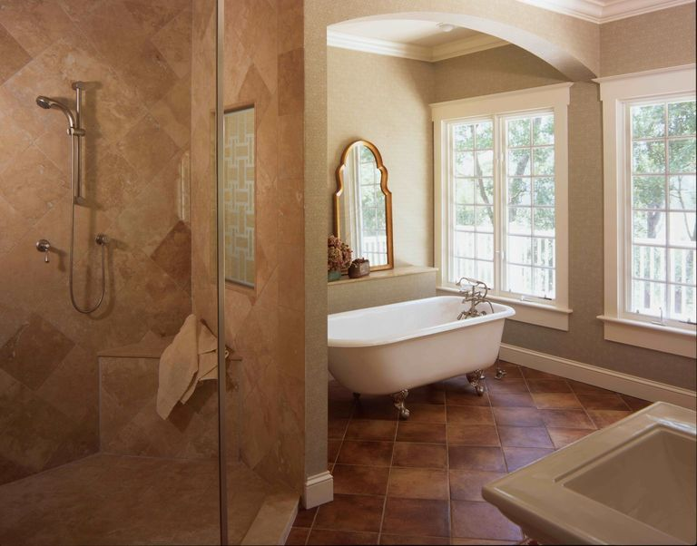 Master bath with claw foot tub and a view