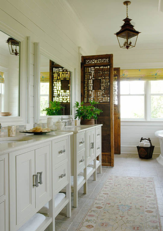 Master bath with his and her sinks and salvaged wooden doors herlong