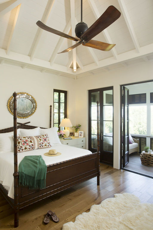 Master bedroom with private porch access and vaulted ceilings