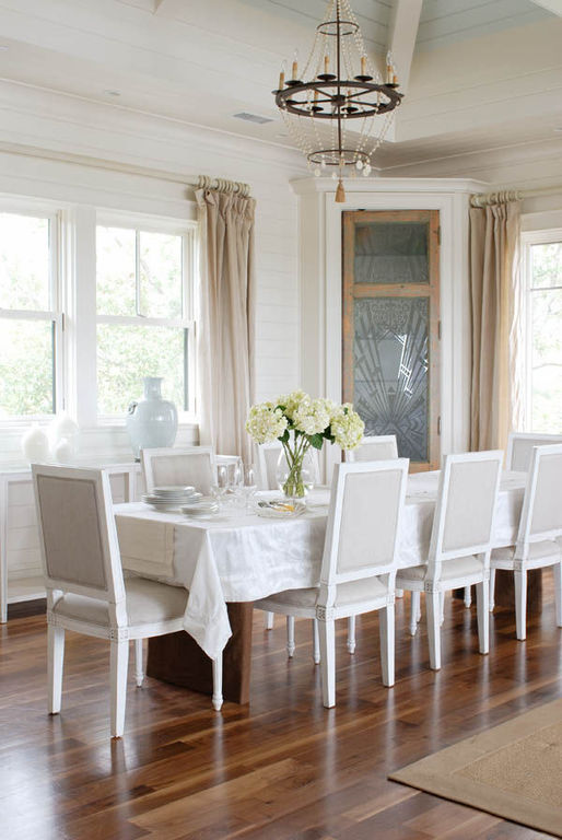 Neutral dining room with vaulted ceiling
