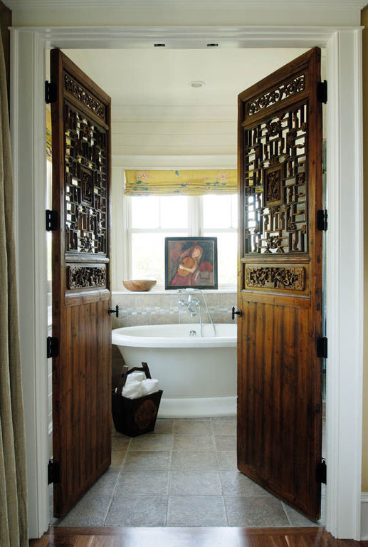 Salvaged doors open to garden tub herlong