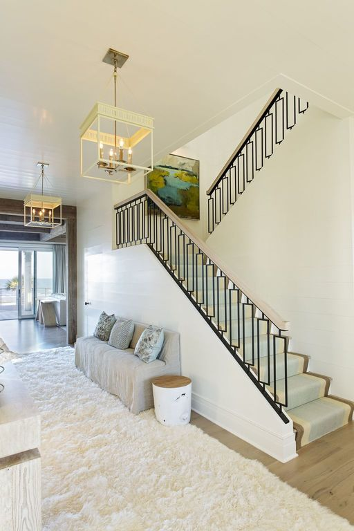 shag rug entry staircase beach house iron work shiplap herlong architects